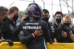 Mercedes driver Lewis Hamilton of Britain celebrates with his team after taking the pole position during qualifying practice for Sunday's Emilia Romagna Formula One Grand Prix, at the Imola track, Italy, Saturday, April 17, 2021. (Bryn Lennon/Pool photo via AP)