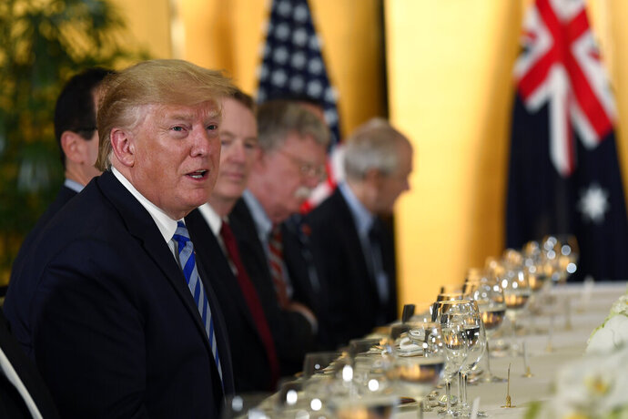 President Donald Trump, left, speaks as he attends a dinner with Australian Prime Minister Scott Morrison in Osaka, Japan, Thursday, June 27, 2019. Trump and Morrison are in Osaka to attend the G20 summit. (AP Photo/Susan Walsh)