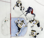 Columbus Blue Jackets' Matt Duchene, top right, scores a goal against Boston Bruins' Tuukka Rask, of Finland, during the second period of Game 3 of an NHL hockey second-round playoff series Tuesday, April 30, 2019, in Columbus, Ohio. (AP Photo/Jay LaPrete)