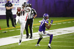 Atlanta Falcons wide receiver Julio Jones (11) catches a pass over Minnesota Vikings cornerback Cameron Dantzler during the second half of an NFL football game, Sunday, Oct. 18, 2020, in Minneapolis. (AP Photo/Bruce Kluckhohn)
