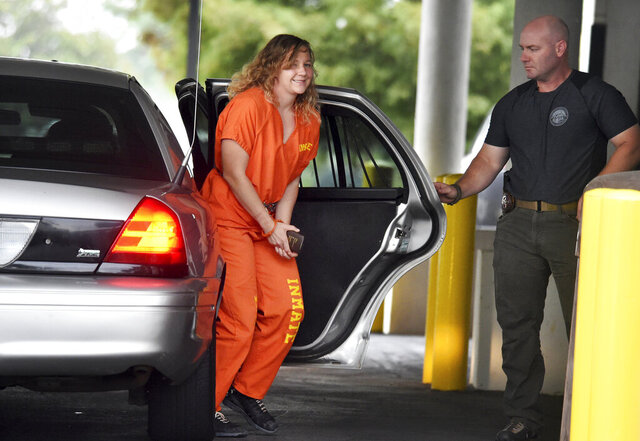FILE - In this Aug. 23, 2018, file photo, Reality Winner arrives at a courthouse in Augusta, Ga., after she pleaded guilty in June to copying a classified U.S. report and mailing it to an unidentified news organization. Winner, a former government contractor serving a prison sentence in Texas after pleading guilty to mailing a classified report to a news organization has tested positive for the coronavirus. Reality Winner's sister, Brittany Winner, tells the Daily Report on Monday, July 20, 2020, that her sister said via email that she got postive test results. (Michael Holahan/The Augusta Chronicle via AP, File)