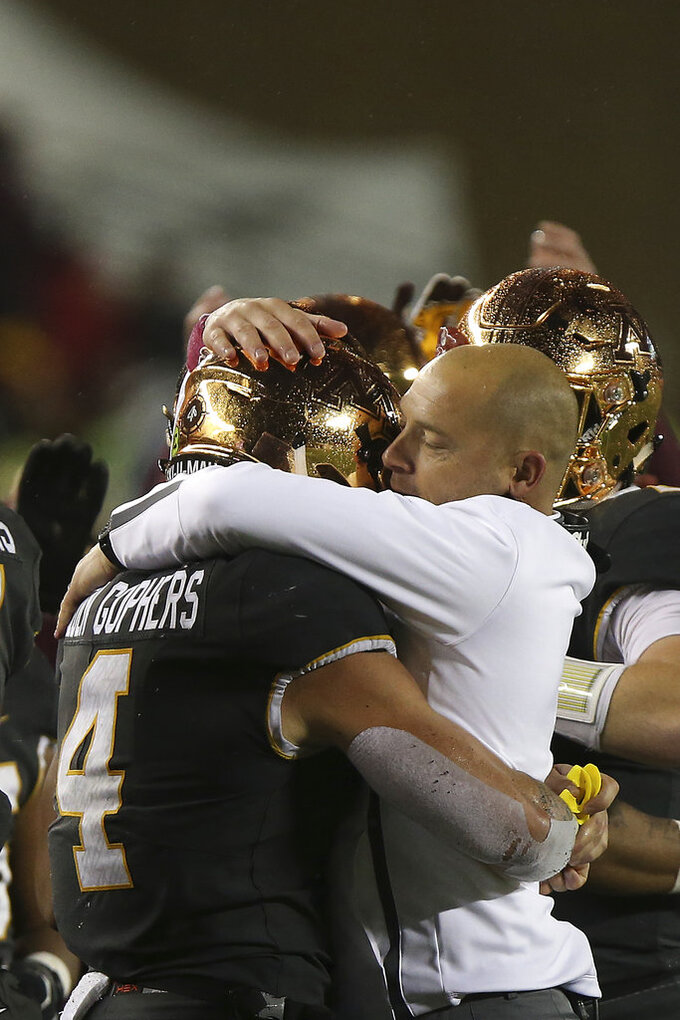 Minnesota's head coach P.J. Fleck hugs Minnesota running back Shannon Brooks after Brooks scored a touchdown against Indiana during an NCAA college football game Friday, Oct. 26, 2018, in Minneapolis. Minnesota won 38-31. (AP Photo/Stacy Bengs)