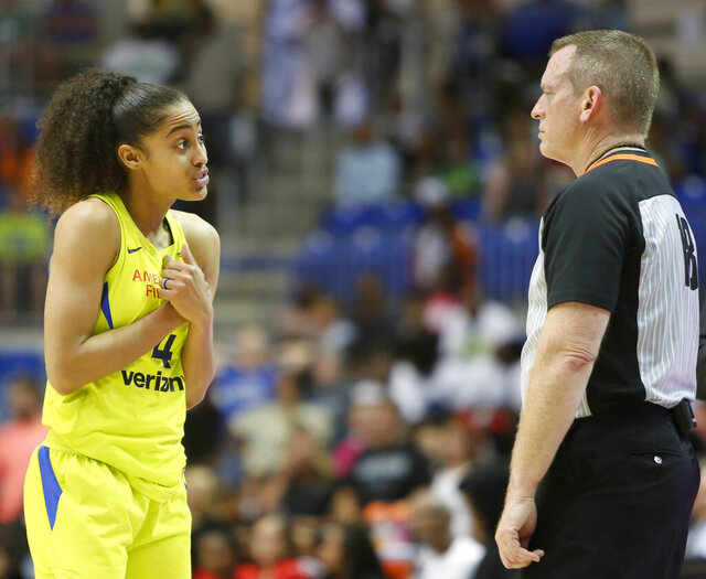 FILE - In this Thursday, July 19, 2018, file photo, Dallas Wings guard Skylar Diggins-Smith (4) speaks with an official during the second half of the team's WNBA basketball game against the Washington Mystics, in Arlington, Texas. Diggins-Smith wants to find a new team to play for in the 2020 WNBA season. (Steve Hamm/The Dallas Morning News via AP, File)