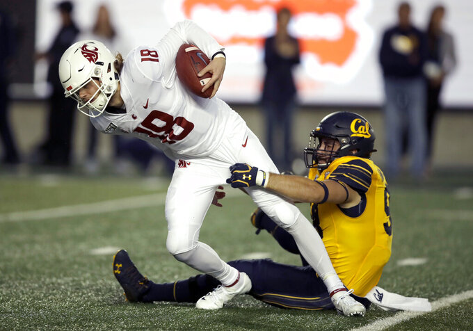 Washington State quarterback Anthony Gordon, left, is sacked by California's Ben Schrider in the first half of an NCAA college football game Saturday, Nov. 9, 2019, in Berkeley, Calif. (AP Photo/Ben Margot)