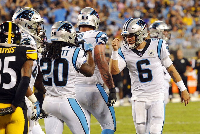 Carolina Panthers quarterback Taylor Heinicke (6) congratulates running back Jordan Scarlett (20) following Scarlett's touchdown against the Pittsburgh Steelers during the second half of an NFL preseason football game in Charlotte, N.C., Thursday, Aug. 29, 2019. (AP Photo/Mike McCarn)