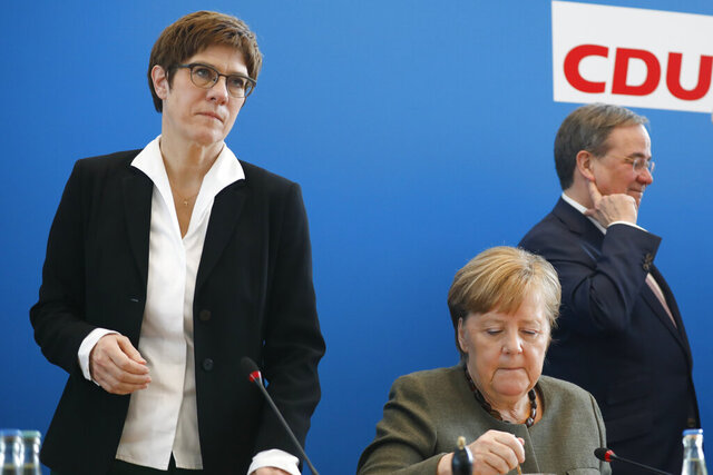 German Chancellor Angela Merkel, center, outgoing party chairwoman Annegret Kramp-Karrenbauer, left, and the governor of German state North Rhine Westphalia Armin Laschet, right, attend a Christian Democratic Union party board meeting at the headquarters in Berlin, Germany, Monday, Feb. 24, 2020. (AP Photo/Markus Schreiber)