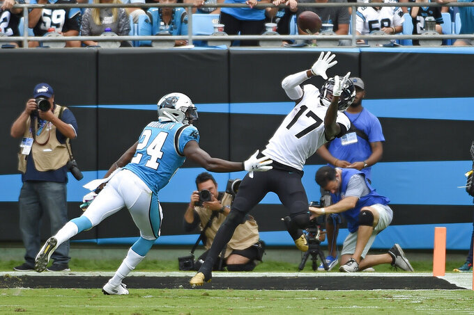 McCaffrey scores 3 TDs, Panthers hold off Jaguars 34-27