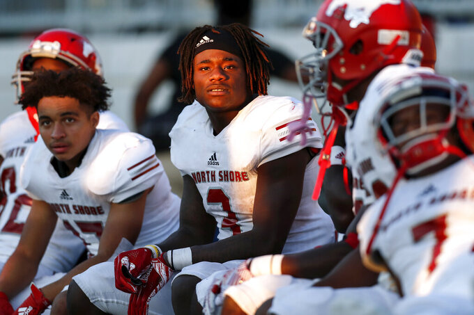 In this Dec. 7, 2019 photo, North Shore Mustangs running back Zachary Evans (3) and teammates watch from the bench induringthe fourth quarter during the second half of the high school football playoff game against the Atascocita Eagles at Sheldon ISD Panther Stadium in Houston, Texas. The talented running back from Houston quietly signed with Georgia in December, but was later released from his national letter of intent by the Bulldogs. (Tim Warner/Houston Chronicle via AP)