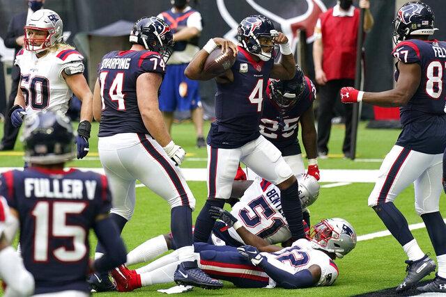 Houston Texans quarterback Deshaun Watson (4) flexes as he celebrates scoring a touchdown against the New England Patriots during the first half of an NFL football game, Sunday, Nov. 22, 2020, in Houston. (AP Photo/David J. Phillip)
