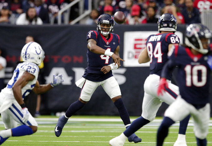 Houston Texans quarterback Deshaun Watson (4) throws against the Indianapolis Colts during the first half of an NFL wild card playoff football game, Saturday, Jan. 5, 2019, in Houston. (AP Photo/Michael Wyke)