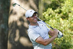 Rory McIlroy, of Northern Ireland hits from the 12th tee during the first round of the BMW Championship golf tournament, Thursday, Aug. 27, 2020, at Olympia Fields Country Club in Olympia Fields, Ill. (AP Photo/Charles Rex Arbogast)