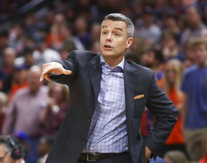 Virginia head coach Tony Bennett reacts to a call during an NCAA college basketball game against Navy in Charlottesville, Va., Sunday, Dec. 29, 2019. (AP Photo/Andrew Shurtleff)