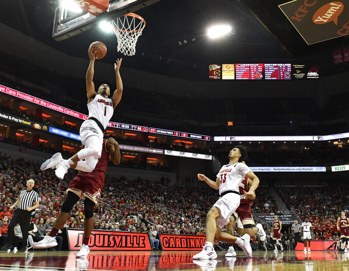 Louisville guard Christen Cunningham (1) goes in for a layup past the defense of Boston College forward Jairus Hamilton (1) during the second half of an NCAA college basketball game in Louisville, Ky., Wednesday, Jan. 16, 2019. Louisville won 80-70. (AP Photo/Timothy D. Easley)