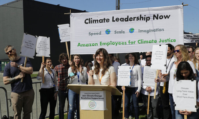 Emily Cunningham, center, who works as a user experience designer at Amazon.com, speaks during a news conference following Amazon's annual shareholders meeting, Wednesday, May 22, 2019, in Seattle held by the group