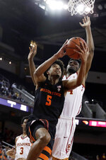 Oregon State guard Ethan Thompson, left, drives to the basket as Southern California's Victor Uyaelunmo, right, defends during the first half of an NCAA college basketball game Saturday, Feb. 23, 2019, in Los Angeles. (AP Photo/Marcio Jose Sanchez)