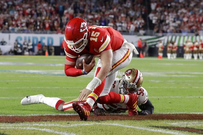 Kansas City Chiefs quarterback Patrick Mahomes (15) runs into the end zone for a touchdown against San Francisco 49ers' Kwon Alexander (56) during the first half of the NFL Super Bowl 54 football game Sunday, Feb. 2, 2020, in Miami Gardens, Fla. (AP Photo/Lynne Sladky)
