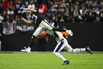 Las Vegas Raiders wide receiver Hunter Renfrow (13) makes a catch over Baltimore Ravens cornerback Marlon Humphrey (44) during the second half of an NFL football game, Monday, Sept. 13, 2021, in Las Vegas. (AP Photo/David Becker)