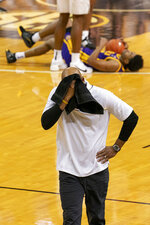 Missouri head coach Cuonzo Martin covers his face after a foul is called during the second half of an NCAA college basketball game against LSU Saturday, March 6, 2021, in Columbia, Mo.  (AP Photo/L.G. Patterson)