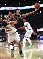Notre Dame guard Prentiss Hubb knocks Georgia Tech guard Jose Alvarado to the hardwood on his way to the basket in the final minutes of an NCAA college basketball game Wednesday, Jan. 15, 2020, in Atlanta. (Curtis Compton/Atlanta Journal-Constitution via AP)