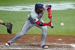 Washington Nationals' Victor Robles (16) drops down a sacrifice bunt off Tampa Bay Rays relief pitcher Ryan Yarbrough during the fifth inning of a baseball game Tuesday, Sept. 15, 2020, in St. Petersburg, Fla. (AP Photo/Chris O'Meara)