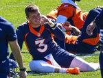 Denver Broncos quarterback Drew Lock (3) jokes during a Denver Broncos OTA at the team's headquarters, Monday, May 24, 2021, in Englewood, Colo. (AP Photo/Jack Dempsey)