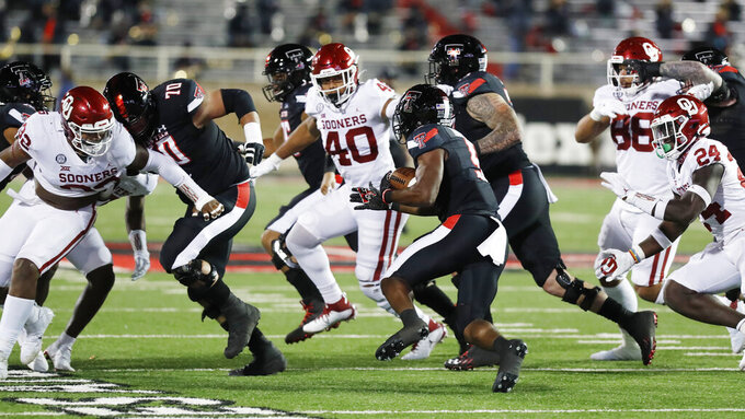 Texas Tech running back Chadarius Townsend carries the ball during the second half of an NCAA college football game, Saturday, Oct. 31, 2020, in Lubbock, Texas. (AP Photo/Mark Rogers)