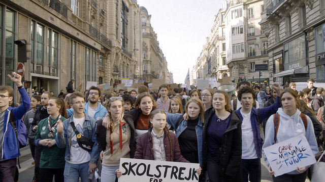This image released by Hulu shows activist Greta Thunberg, center, in a scene from the documentary