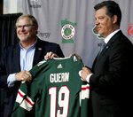 Minnesota Wild NHL hockey team owner Craig Leipold, left, poses with new team general manager Bill Guerin at a press conference in St. Paul, Minn., Thursday, Aug. 22, 2019.  (David Joles/Star Tribune via AP)