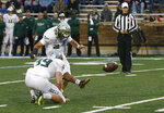 South Florida placekicker Coby Weiss (24) boots a field goal as punter Trent Schneider (39) holds in the first half of an NCAA college football game against Tulsa in Tulsa, Okla., Friday, Oct. 12, 2018. (AP Photo/Sue Ogrocki)