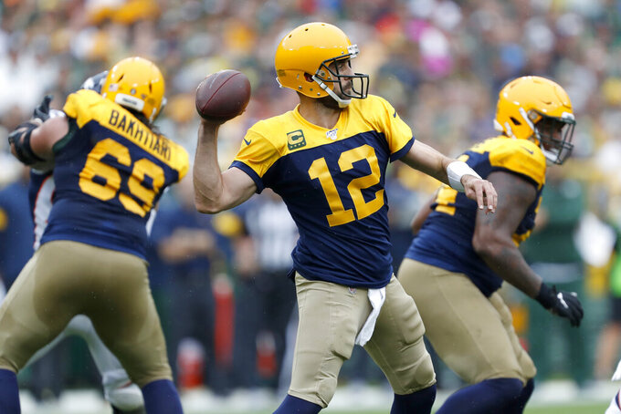 Green Bay Packers quarterback Aaron Rodgers throws during the first half of an NFL football game against the Denver Broncos Sunday, Sept. 22, 2019, in Green Bay, Wis. (AP Photo/Matt Ludtke)