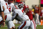 Oklahoma linebacker Kenneth Murray (9) tackles Texas Tech running back Armand Shyne (5) in the second quarter of an NCAA college football game in Norman, Okla., Saturday, Sept. 28, 2019. (AP Photo/Sue Ogrocki)