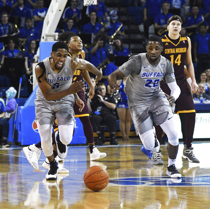 Buffalo's C.J. Massingburg, left, and Dontay Caruthers run for a stolen ball during the last minute of an NCAA college basketball game against Central Michigan in Buffalo, N.Y., Saturday, Feb. 9, 2019. (AP Photo/Heather Ainsworth)