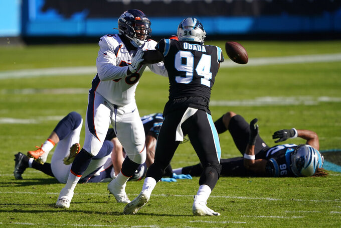Carolina Panthers defensive end Efe Obada (94) recovers a fumble under pressure from Denver Broncos offensive tackle Calvin Anderson during the first half of an NFL football game Sunday, Dec. 13, 2020, in Charlotte, N.C. (AP Photo/Brian Blanco)