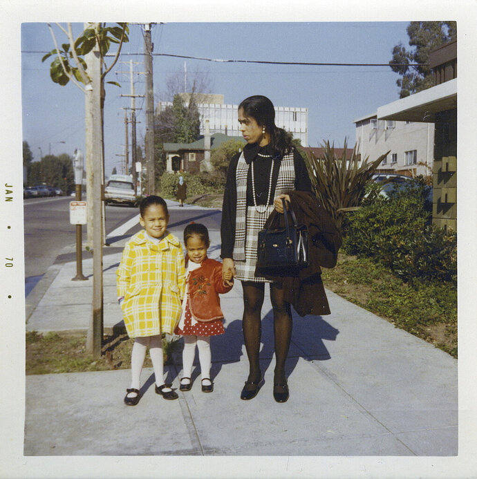 "FILE - This January 1970 photo provided by the Kamala Harris campaign shows her, left, with her sister, Maya, and mother, Shyamala, outside their apartment in Berkeley, Calif. On Friday, June 28, 2019, The Associated Press reported on stories circulating online incorrectly asserting that Harris lied during the Thursday, June 27, 2019 Democratic debate when she said she was part of ""the second class to integrate"" Berkeley Public Schools, with users sharing Berkeley High School yearbook photos showing black and white students attending the school in the 1960s. Harris, however, wasn't talking about Berkeley High School. She didn't enter the school system until 1969, at age five. The school didn't agree to desegregate all 14 elementary schools until the beginning of the 1968 school year. (Kamala Harris campaign via AP)"