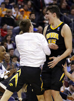 Iowa's Luka Garza, right, celebrates with a teammate after Iowa defeated Cincinnati 79-72 during a first round men's college basketball game in the NCAA Tournament in Columbus, Ohio, Friday, March 22, 2019. (AP Photo/Tony Dejak)