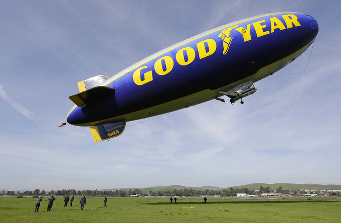 FILE - In this Friday, Feb. 5, 2016, file photo, the Goodyear Blimp Spirit of Innovation takes off for a flight over Super Bowl fan sites from the airport in Livermore, Calif. As a nod to its influence and legacy to the game, the iconic airship is being inducted into the College Football Hall of Fame as an honorary member — the first non-player or coach to be inducted. The blimp's flight to fame began during the telecast for the 1955 Rose Bowl Game and has led to it being an eye in the sky at over 2,000 games, hovering above stadiums from coast to coast. (AP Photo/Eric Risberg, File)