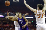 TCU guard Desmond Bane (1) is fouled by Texas forward Brock Cunningham, left, as he tries to score during the first half of an NCAA college basketball game in Austin, Texas, Wednesday, Feb. 19, 2020. (AP Photo/Eric Gay)