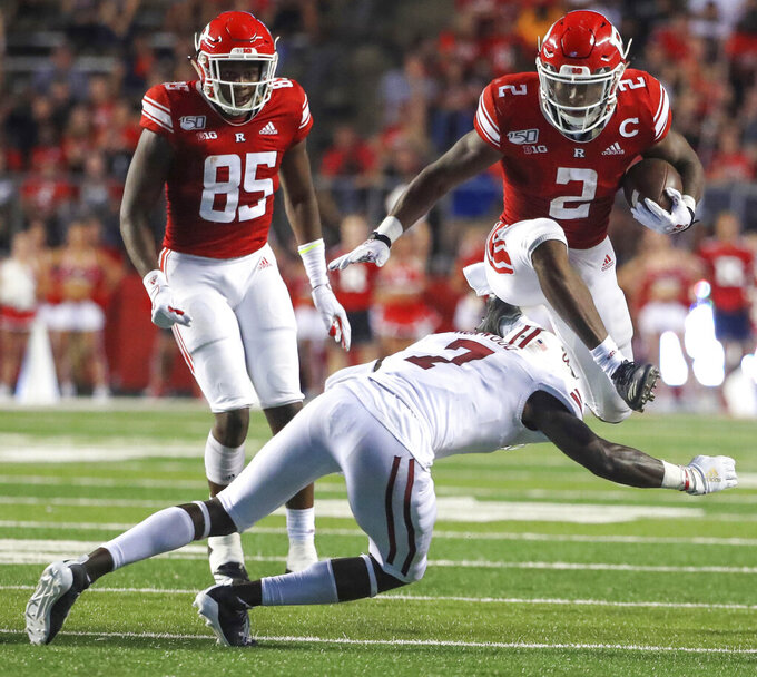 Rutgers running back Raheem Blackshear (2) hurdles Massachusetts safety Joseph Norwood (7) on a 20-yard reception during the second quarter of an NCAA college football game Friday, Aug. 30, 2019, in Piscataway, N.J. (Andrew Mills/NJ Advance Media via AP)