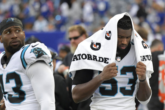 Carolina Panthers defensive end Brian Burns reacts during the second half of an NFL football game against the New York Giants, Sunday, Oct. 24, 2021, in East Rutherford, N.J. The Giants won 25-3. (AP Photo/Bill Kostroun)