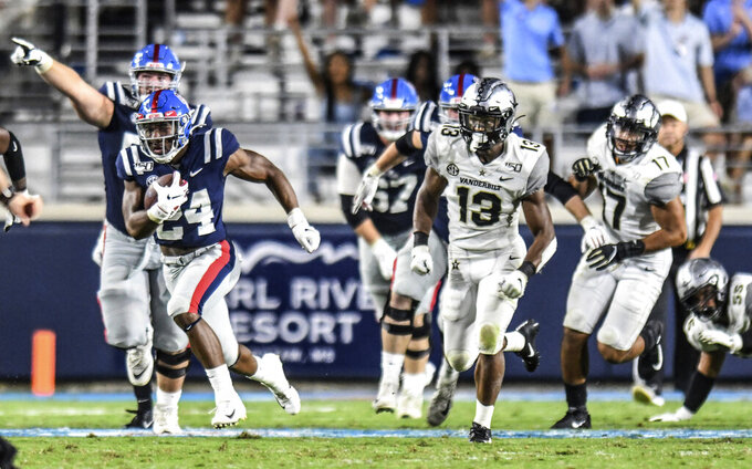 Mississippi running back Snoop Conner (24) scores on a long run in the third quarter against Vanderbilt during an NCAA college football game in Oxford, Miss., Saturday, Oct. 5, 2019. (Bruce Newman/The Oxford Eagle via AP)