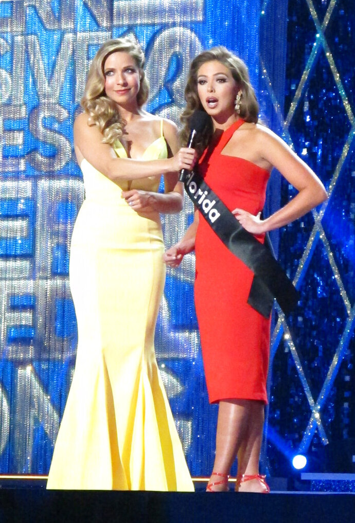 Miss America 2015 Kira Kazantsev, left, conducts an onstage interview with Miss Florida Taylor Tyson during the second night of preliminary competition in the Miss America competition in Atlantic City N.J. on Thursday Sept. 6, 2018. Tourism generated $44.7 billion in spending in New Jersey in 2018, Gov. Phil Murphy announced on May 9, 2019. (AP Photo/Wayne Parry)