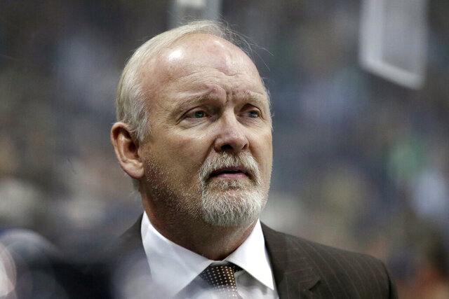 FILE - In this Jan. 14, 2017, file photo, then-Dallas Stars head coach Lindy Ruff watches play against the Minnesota Wild in the first period of an NHL hockey game in Dallas. A person with knowledge of the talks tells The Associated Press that the New Jersey Devils are hiring veteran coach Lindy Ruff to take over one of the NHL's youngest teams and removing the interim tag off Tom Fitzgerald's title as general manager.  (AP Photo/LM Otero, File)
