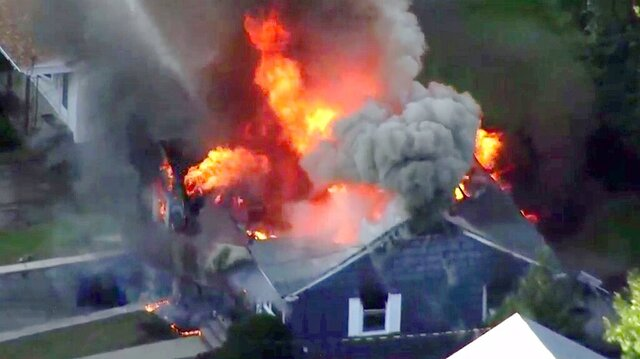 FILE-- In this Sept. 13, 2018 file image taken from video provided by WCVB in Boston, flames consume a home of Lawrence, Mass. police officer Ivan Soto in Lawrence, Mass, a suburb of Boston. Columbia Gas of Massachusetts was ordered Tuesday, June 23, 2020, to pay a $53 million criminal fine for causing a series of natural gas explosions in Lawrence and nearby towns that killed one person and damaged dozens of homes. The company was sentenced more than three months after the it pleaded guilty in federal court to causing the blasts. (WCVB via AP, File)
