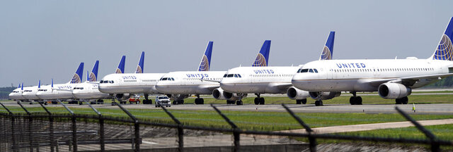 FILE - In this March 25, 2020 file photo, United Airlines planes are parked at George Bush Intercontinental Airport in Houston. United Airlines will send layoff warnings to 36,000 employees - nearly half its U.S. staff - in the clearest signal yet of how deeply the virus outbreak is hurting the airline industry. United officials said Wednesday, July 8 that they still hope to limit the number of layoffs by offering early retirement, but they have to send notices this month to comply with a law requiring that workers get 60 days' notice ahead of mass job cuts.  (AP Photo/David J. Phillip, File)