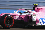 CORRECTS ID OF DRIVER Racing Point driver Lance Stroll of Canada steers his car during the first practice session for the British Formula One Grand Prix at the Silverstone circuit in Silverstone, England, Friday, July 31, 2020. The British Formula One Grand Prix race will be held on Sunday. (Bryn Lennon/Pool via AP)