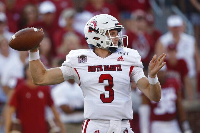 South Dakota quarterback Austin Simmos (3) throws in the first throws in the quarter of an NCAA college football game against Oklahoma Saturday, Sept. 7, 2019, in Norman, Okla. (AP Photo/Sue Ogrocki)