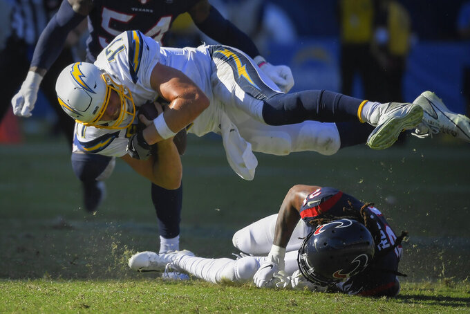 Los Angeles Chargers quarterback Philip Rivers is tackled by Houston Texans cornerback Bradley Roby during the second half of an NFL football game Sunday, Sept. 22, 2019, in Carson, Calif. (AP Photo/Mark J. Terrill)