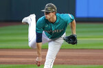 Seattle Mariners starting pitcher Chris Flexen follows through as he throws against the Cleveland Indians in the first inning of a baseball game Friday, May 14, 2021, in Seattle. (AP Photo/Elaine Thompson)