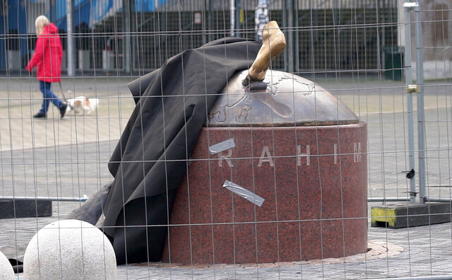 A black cloth used to hide the vandalized statue of Zlatan Ibrahimovic uncovers a bronze foot from the block of stone, outside the stadium of Malmo's soccer team in Malmo, Sweden, Thursday, Jan. 16, 2020. Two feet are all that remains of the local hero and one of Sweden's greatest ever sports stars. After a series of attacks by vandals, the statue is holed up in a secret location undergoing repairs. (AP Photo/David Keyton)