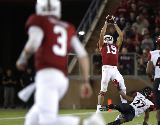 Stanford wide receiver JJ Arcega-Whiteside (19) catches a pass for a touchdown from quarterback K.J. Costello (3) against San Diego State cornerback Kyree Woods (27) during the second half of an NCAA college football game Friday, Aug. 31, 2018, in Stanford, Calif. (AP Photo/Tony Avelar)